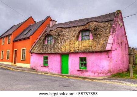 Old pink cottage house in Ireland