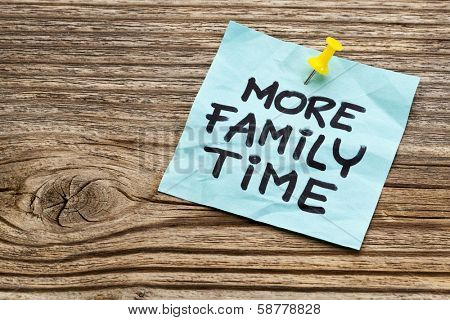 more family time reminder note against grained weathered wood