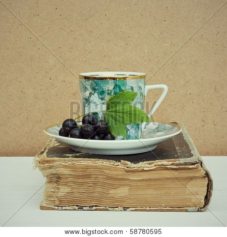 Vintage Books And Cup Of Tea On Wooden Table