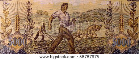 GREECE - CIRCA 1942: Farmers Sowing and Plowing on 5000 Drachmai 1942 Banknote from Greece.