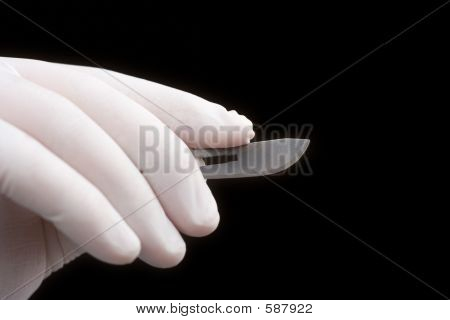 Surgeon holding a blade