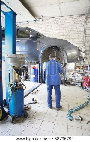 the image of a  mechanic repairing a car