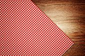 image of oblique  - Table cloth kitchen napkin on wooden table as background - JPG