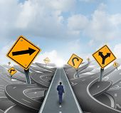 picture of crossroads  - Businessman walking around confusion and chaos on a straight easy path and journey to success as a business metaphor for leadership solution to financial challenges - JPG