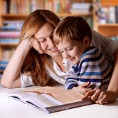 stock photo of bible story  - Mother reading Bible stories to her boy - JPG