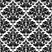 stock photo of embellish  - Black and white floral arabesque pattern with a geometric diamond shape in a seamless background vector design - JPG