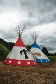 stock photo of tipi  - Two tipi for Indian camp outdoor in nature - JPG