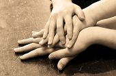 foto of fellowship  - Several children hands on top of each other - JPG