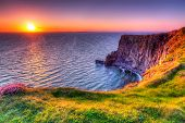 stock photo of atlantic ocean  - Cliffs of Moher at sunset - JPG