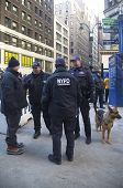 NYPD counter terrorism officers and NYPD transit bureau K-9 police officer with K-9 dog