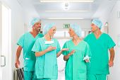 Hospital - medical surgery team is ready for the operation, the women and men wearing scrubs in a cl