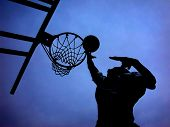 picture of ncaa  - basketball play contrasted against a stunning sky - JPG