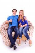picture of coca-cola  - Young people sitting on a sofa and drinking Coca Cola isolated - JPG