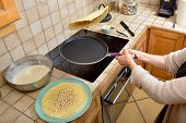 pic of sugar paste  - pancake batter into a pan on an induction hotplate - JPG
