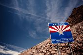 stock photo of dam  - Arizona sign at Hoover Dam on the border with Nevada - JPG