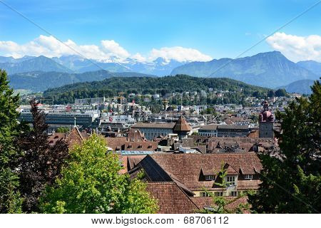 LUCERN, SWITZERLAND - JULY 3, 2014: Overview of Lucern, Switzerland. From the Musegg Wall you get a beautiful vista of the city including churches, and other public buildings.