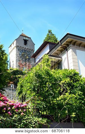 LUCERN, SWITZERLAND - JULY 3, 2014: Zyt Tower the Musegg Wall, Lucern. It is the oldest city clock, built by Hans Luter in 1535, and chimes every hour one minute before all the other city clocks.