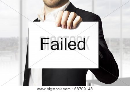 Businessman Holding Sign Failed