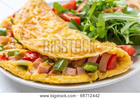Delicious Egg Omelet with Ham and Vegetables on the Plate