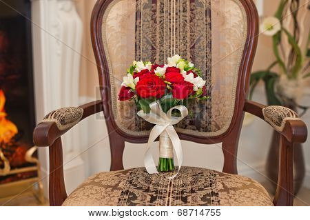Bunch Of Flowers On A Chair.