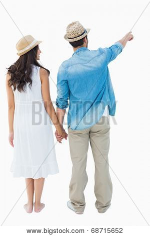 Happy hipster couple holding hands and looking on white background