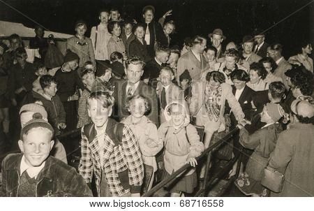 JUIST, GERMANY, CIRCA FIFTIES - Vintage photo of group of children during a school trip