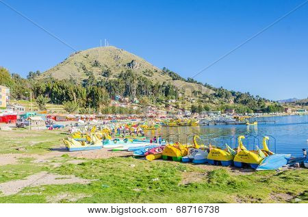 COPACABANA, BOLIVIA, MAY 6, 2014 - Pedal boats for hire in port of Copacabana at Titicaca lake shore