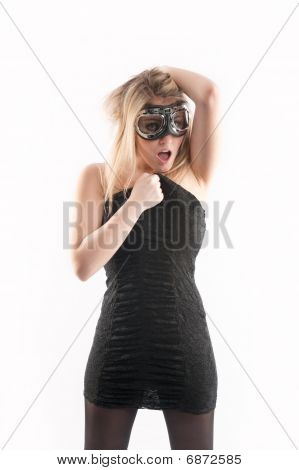 Sexy girl in a black dress wearing goggles with expression.