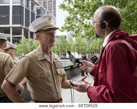 NEW YORK - MAY 23, 2014: U.S. Marine Lt. General William Faulkner interviewed by Peter Haskell of WCBS 880 after the re-enlistment and promotion ceremony at the National September 11 Memorial site.