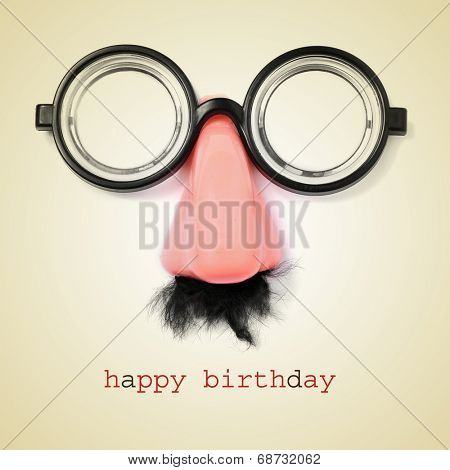 sentence happy birthday and fake eyeglasses, nose and mustache on a beige background, with a retro effect