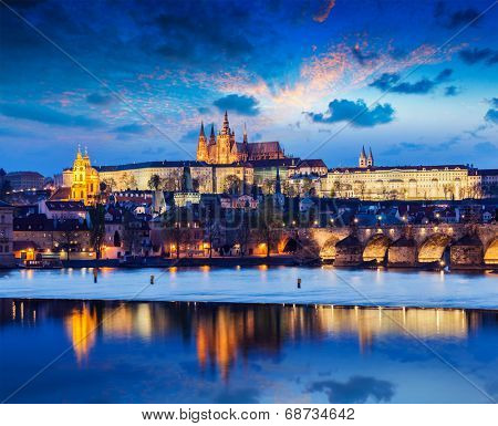 Travel Prague Europe concept background - view of Charles Bridge and Prague Castle in twilight. Prague, Czech Republic