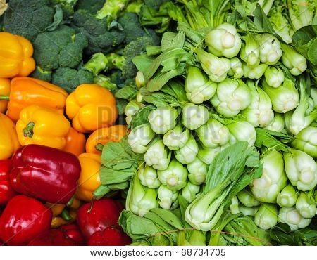 Vegetables in Asian market close up: Capsicum bell peppers, broccoli  cabbage, Green chinese cabbage