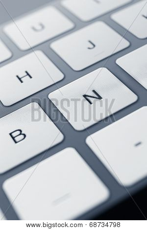 Close up view of keys of computer keyboard. Concept of technology and peripheral devices