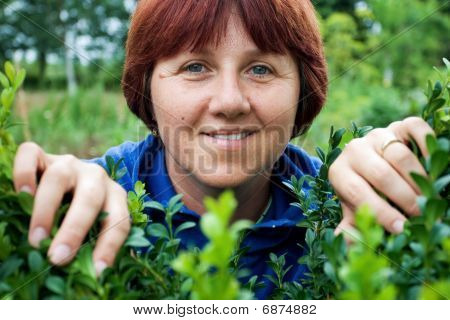 Woman Peeking Through Green Leafs