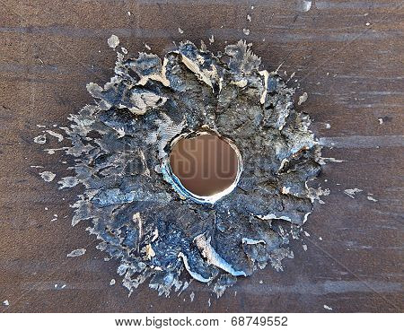 Bullet Hole On Iron Surface