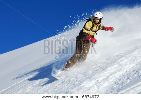 Young lady snowboarder riding