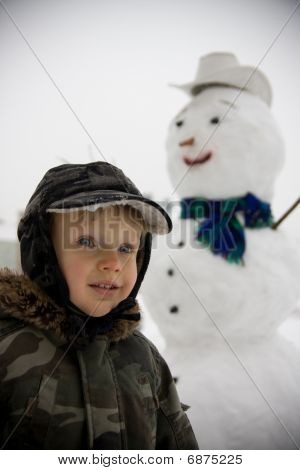 Little Boy And Snowman