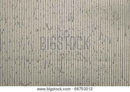 Water Drops On A Corrugated Plate Of Beige Color