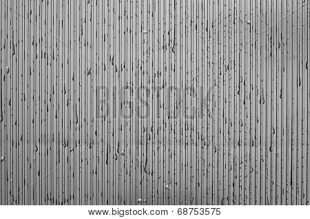 Water Drops On A Corrugated Plate Of Gray Color