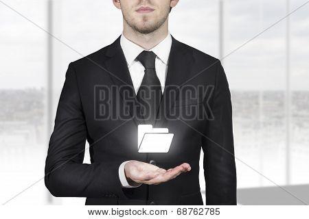 Businessman Holding Folder Symbol In Open Hand