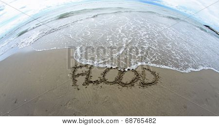 Sea Wave That Erases The Word Flood On The Sea Beach 2