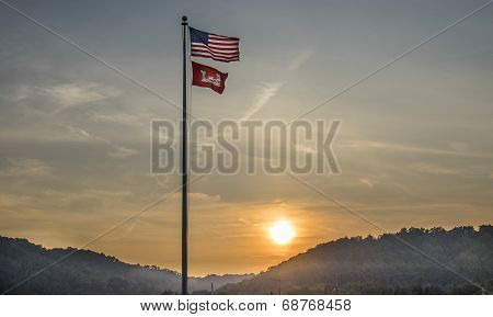 American Flag with Castle Flag during Sunset.