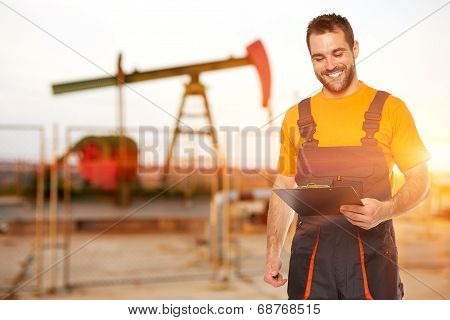 Refinery Worker Reads The Data From The Black Plates