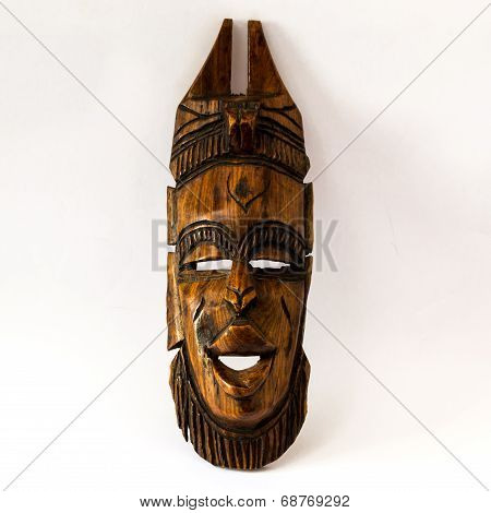 Wooden African Mask On A White Paper
