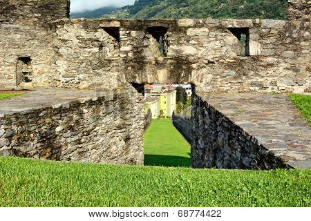 BELLINZONA, SWITZERLAND - JULY 4, 2014: Lawn and Ramparts at Castelgrande, Bellinzona. A UNESCO World Heritage Site, the fortress overlooks the town of Bellinzona providing dramatic vistas.