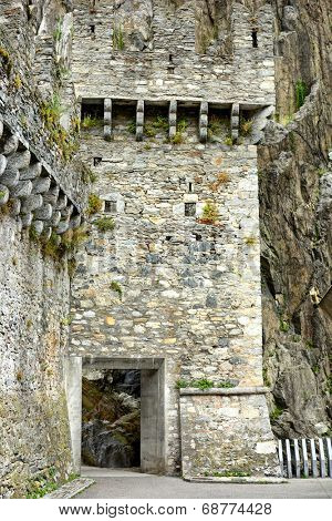 BELLINZONA, SWITZERLAND - JULY 4, 2014: The entrance to Castelgrande, Bellinzona. The portal with access from the Piazza del Sole leads to an elevator and stairs to take you to the top of the ramparts