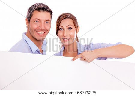 advertising couple smiling joyful holding banner chalkobard