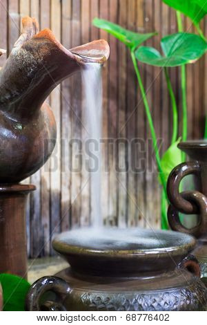 Water Drop From Clay Jug In Natural Garden To Thai Style Antique Basin