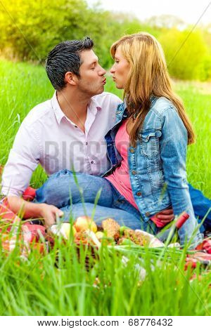outdoor kissing relaxing couple together