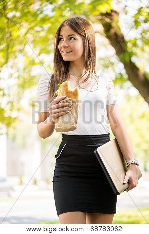 Businesswoman Taking A Break For Breakfast Outoor